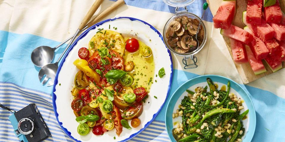 """<p>Before you dig into <a href=""""https://www.goodhousekeeping.com/food-recipes/g1553/burger-recipes/"""" rel=""""nofollow noopener"""" target=""""_blank"""" data-ylk=""""slk:burgers"""" class=""""link rapid-noclick-resp"""">burgers</a> and hot dogs, kick off your holiday family barbecue with these 4th of July appetizers. Follow these easy recipes full of summer's freshest produce — zucchini, corn, <a href=""""https://www.goodhousekeeping.com/food-recipes/a27198230/how-to-cut-a-watermelon/"""" rel=""""nofollow noopener"""" target=""""_blank"""" data-ylk=""""slk:watermelon"""" class=""""link rapid-noclick-resp"""">watermelon</a>, and more — to make a flavor-packed party spread that's just as colorful as it is delicious. It doesn't matter if you're feeding a crowd or making something extra special for the fam, we think there's something that everyone will be able to enjoy on this list.</p><p>Whether your family prefers to keep it classic (shall we say, all-American?) with pigs in a blanket and grilled veggies, or go fancy with homemade dip and <a href=""""https://www.goodhousekeeping.com/pasta-salad-recipes/"""" rel=""""nofollow noopener"""" target=""""_blank"""" data-ylk=""""slk:pasta salad"""" class=""""link rapid-noclick-resp"""">pasta salad</a>, start your Independence Day menu with these crowd-pleasing party starters. Who knows? You may just find the dish that you'll be craving before meals all summer long. But remember: Even though eating an entire bowl of <a href=""""https://www.goodhousekeeping.com/food-recipes/cooking/g19684647/how-to-make-guacamole/"""" rel=""""nofollow noopener"""" target=""""_blank"""" data-ylk=""""slk:guacamole"""" class=""""link rapid-noclick-resp"""">guacamole</a> sounds like a good idea, try your best — key word: try — to save room for your <a href=""""https://www.goodhousekeeping.com/food-recipes/g413/great-grilling-recipes/"""" rel=""""nofollow noopener"""" target=""""_blank"""" data-ylk=""""slk:BBQ mains"""" class=""""link rapid-noclick-resp"""">BBQ mains</a>, <a href=""""https://www.goodhousekeeping.com/food-recipes/easy/g27408619/bbq-side-dishes/"""" rel=""""nofollow noopener"""" target="""""""