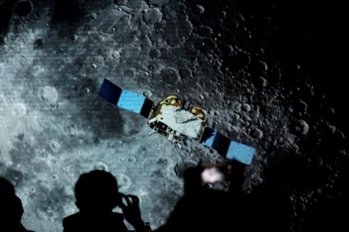 Screen shows footages of spacecraft for Chang'e-5 Mission, during an event on China's lunar exploration program, at the National Astronomical Observatories of Chinese Academy of Sciences, in Beijing