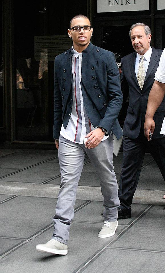 """Troubled R&B singer Chris Brown got a good report card from the judge on Thursday. So far, the 20-year-old has met the terms of his probation sentence for assaulting former girlfriend Rihanna last year, and has completed 32 of his 180 days of community labor. Kraatz/London Ent/<a href=""""http://www.splashnewsonline.com"""" target=""""new"""">Splash News</a> - February 18, 2010"""