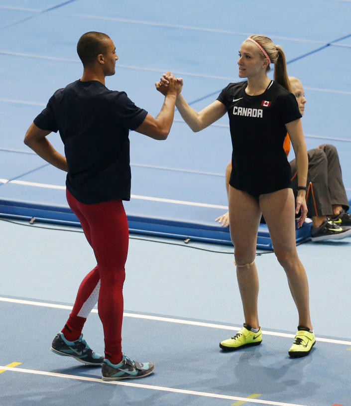 United States' Ashton Eaton, left, and his wife Canada's Brianne Theisen Eaton stand together during the Athletics World Indoor Championships in Sopot, Poland, Friday, March 7, 2014. (AP Photo/Petr David Josek)