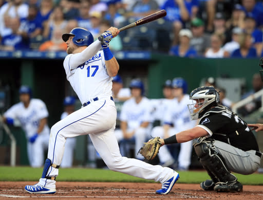 Kansas City Royals' Hunter Dozier hits an RBI triple off Chicago White Sox starting pitcher Dylan Cease during the first inning of a baseball game at Kauffman Stadium in Kansas City, Mo., Tuesday, July 16, 2019. (AP Photo/Orlin Wagner)