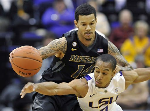 LSU guard Charles Carmouche, right, knocks the ball loose from Missouri guard Negus Webster-Chan during the first half of an NCAA college basketball game at the Pete Maravich Assembly Center in Baton Rouge, La., Wednesday, Jan. 30, 2013. Carmouche scored on after the steal. (AP Photo/Bill Feig)