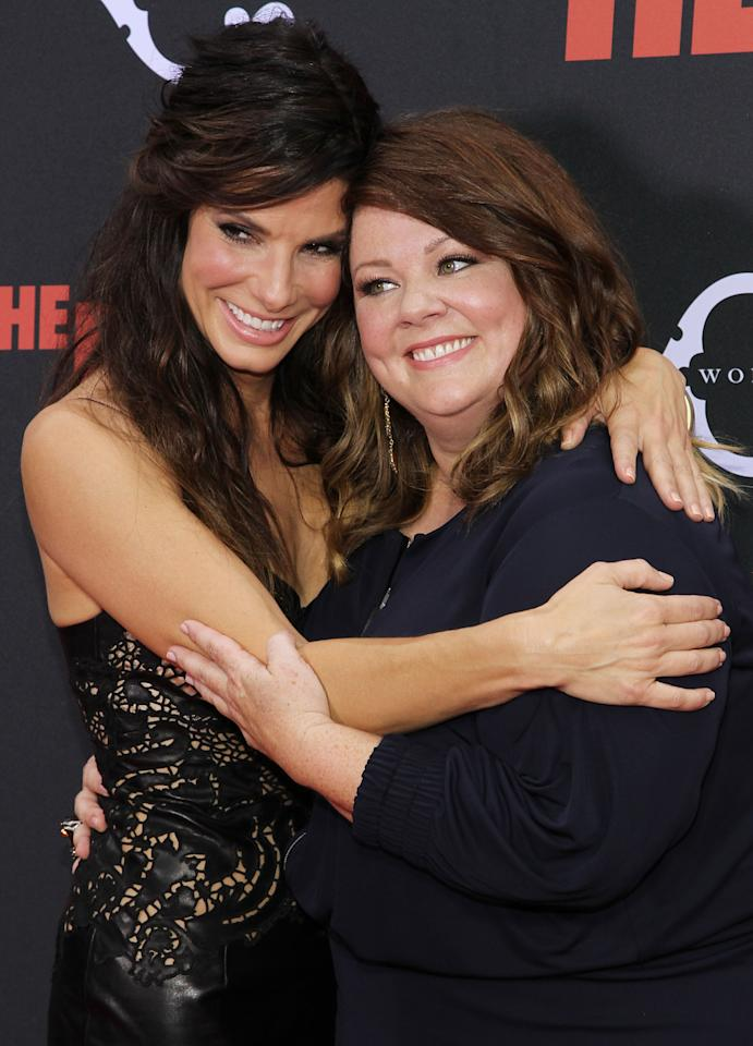 """NEW YORK, NY - JUNE 23: Sandra Bullock (L) and Melissa McCarthy attend """"The Heat"""" New York Premiere at Ziegfeld Theatre on June 23, 2013 in New York City. (Photo by Rob Kim/Getty Images)"""