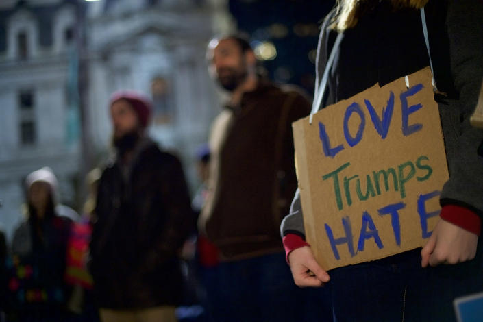 <p>Mary Koger (right), 20, joins protesters demonstrating against president-elect Donald Trump on November 13, 2016 in Philadelphia, Pennsylvania. Trump won a tightly contested race against Hillary Clinton. (Mark Makela/Getty Images) </p>