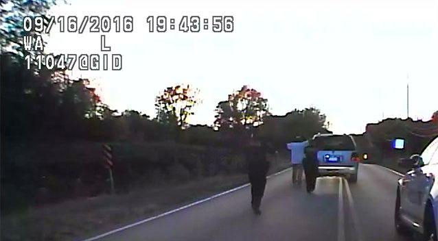 Footage from a police car shows Terrence Crutcher with his arms raised. Photo: AP