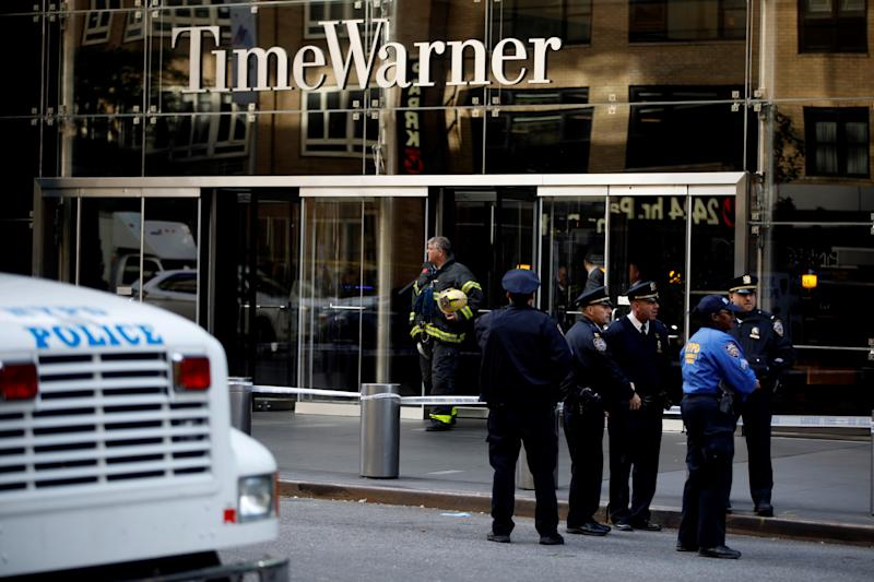 NEW YORK, USA - OCTOBER 24: Police officers take security measures in front of the Time Warner Building where a suspected explosive device was found in the building after it was delivered to CNN's New York bureau in New York, United States on October 24, 2018. Explosive devices were also found near the home of former US Presidents Bill Clinton and Barack Obama in New York. (Photo by Atilgan Ozdil/Anadolu Agency/Getty Images)
