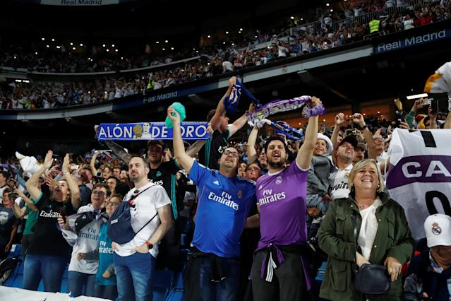 Soccer Football - Real Madrid fans watch the Champions League Final - Madrid, Spain - May 26, 2018 Real Madrid fans react as they watch the match inside the Santiago Bernabeu REUTERS/Javier Barbancho
