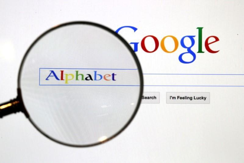 FILE PHOTO: A Google search page is seen through a magnifying glass in this photo illustration taken in Berlin
