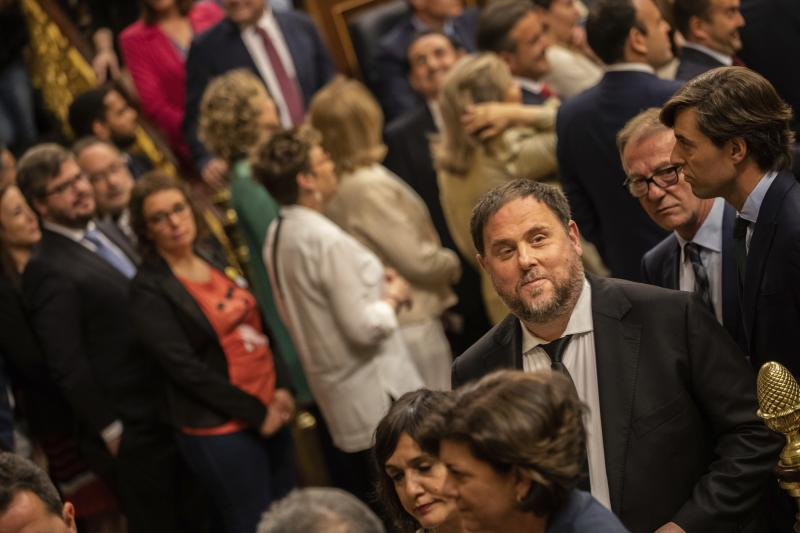 Former Catalan regional Vice President Oriol Junqueras, bottom right, queues to cast a vote at the Spanish parliament in Madrid, Spain, Tuesday, May 21, 2019. Escorted by police, four separatists on trial for Catalonia's 2017 secession attempt, including former Catalan regional Vice President Oriol Junqueras, appeared in the Congress of Deputies. Former Catalan regional minister for international relations, Raul Romeva, was ferried to the Senate's seat from a jail some 40 kilometers outside of Madrid. (AP Photo/Bernat Armangue, Pool)