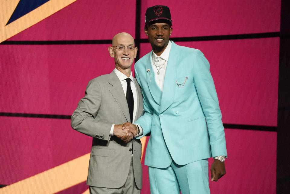Evan Mobley, right, poses for a photo with NBA Commissioner Adam Silver after being selected third overall by the Cleveland Cavaliers during the NBA basketball draft, Thursday, July 29, 2021, in New York. - Credit: AP