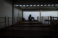 Mamadou Patherazi, from Guinea, sits on a bunk bed of the Modern Christian Mission Church in Fuerteventura, one of the Canary Islands, Spain, on Saturday, Aug. 22, 2020. The Modern Christian Mission is the main shelter for rescued migrants on the island of Fuerteventura. Some 4,000 migrants have reached the Canaries so far this year, the most in over a decade, raising alarm at the highest levels of the Spanish government. (AP Photo/Emilio Morenatti)