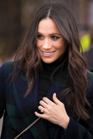<p>On February 13 2018, Meghan joined Prince Harry on their debut joint trip to Edinburgh to greet flag-bearing crowds. For the occasion, she opted for her now-famous brushed out waves. <em>[Photo: Getty]</em> </p>