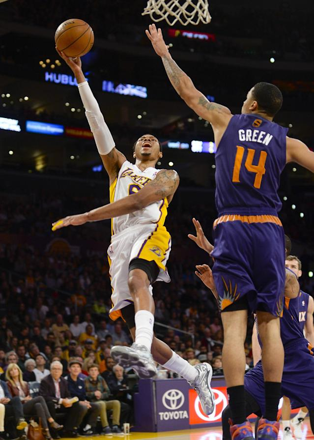 Los Angeles Lakers guard Kent Bazemore (6) drive on Phoenix Suns guard Gerald Green (14) for a basket on a fast break in the first half of an NBA basketball game, Sunday, March 30, 2014, in Los Angeles.(AP Photo/Gus Ruelas)
