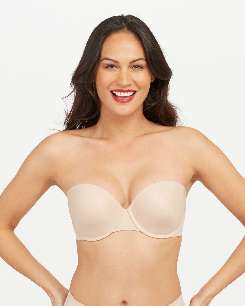 """<p><strong>Key selling points:</strong> With foam cups that mold to your body, convertible straps, and solid construction, this pick from Spanx is a no-brainer. It's made with a patent-pending elastic-free technology that keeps everything secure without ever digging in—truly the dream.</p> <p><strong>What customers say:</strong> """"100% recommend! The strap has a rubber like backing that holds to the skin. It's super comfortable. I'm never messing with it or afraid it will fall. Fits like a woman designed this bra."""" <em>—Sylvia, reviewer on</em> <a href=""""https://cna.st/affiliate-link/EZxaaYGVb4325Nx86PXMnkxuC4ttGiP2tvCEP2wGVCDN7pEySzn9bTt3UbtmS1TRiCdK4koVYohvQqAywZCRJDA3vU3YxkfehznCEjvbcJXSpa3qUXAPGNwpPFvTbaLgBC8Ha48Hs4uFuPFgWX7hNVu9DSMJ6KB88Yu4UaMF9gYmPjb9ay8FD5VD5g1tgHWH4nYja53WJoZjD6bDY1WEnc6aR7hxN8SefbisUURin7ESpsFfjtYYzpuAWHNVwvumHjJg8J4SVzhSBA2GPhbz5tguzVhh3TfUgKCeGLWC593cLPAkN5zh7sgjM84G5rVrFyCGXSTyZBMj8gQAfmSTPRHYZ9HvfdAkmEpB8ZdwR1Nb92anJy3whDhR3CGr4vm8wMdWhyaXV6oJHtXi6E8ntDmUfbBjWMkG8YrH3nUpPjta2FdVgaEbD5ShR3uf5yeJyXK7?cid=60b7e0d814c178687b29db74"""" rel=""""nofollow noopener"""" target=""""_blank"""" data-ylk=""""slk:Bare Necessities"""" class=""""link rapid-noclick-resp""""><em>Bare Necessities</em></a></p> $74, Spanx. <a href=""""https://www.spanx.com/bras/comfy-bras/up-for-anything-strapless-bra"""" rel=""""nofollow noopener"""" target=""""_blank"""" data-ylk=""""slk:Get it now!"""" class=""""link rapid-noclick-resp"""">Get it now!</a>"""