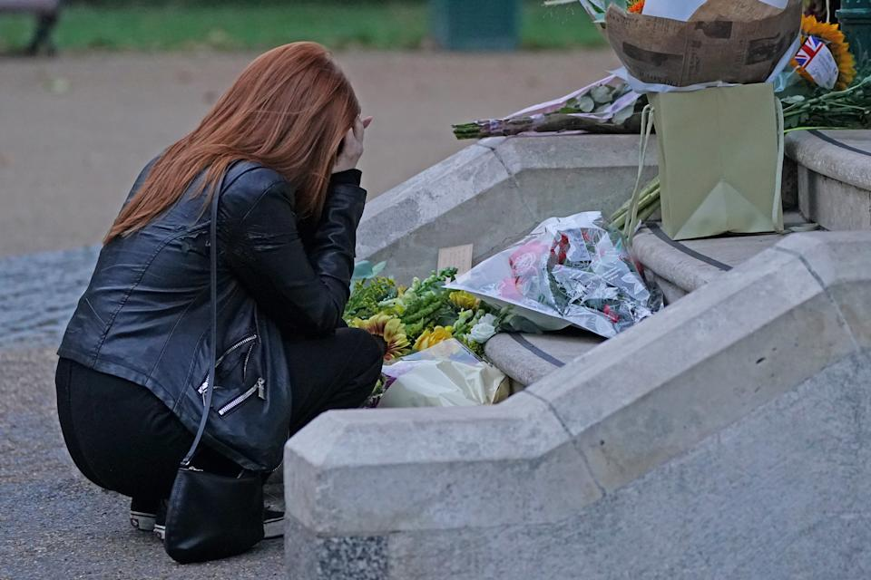 Patsy Stevenson lays a candle at Clapham Common, London.
