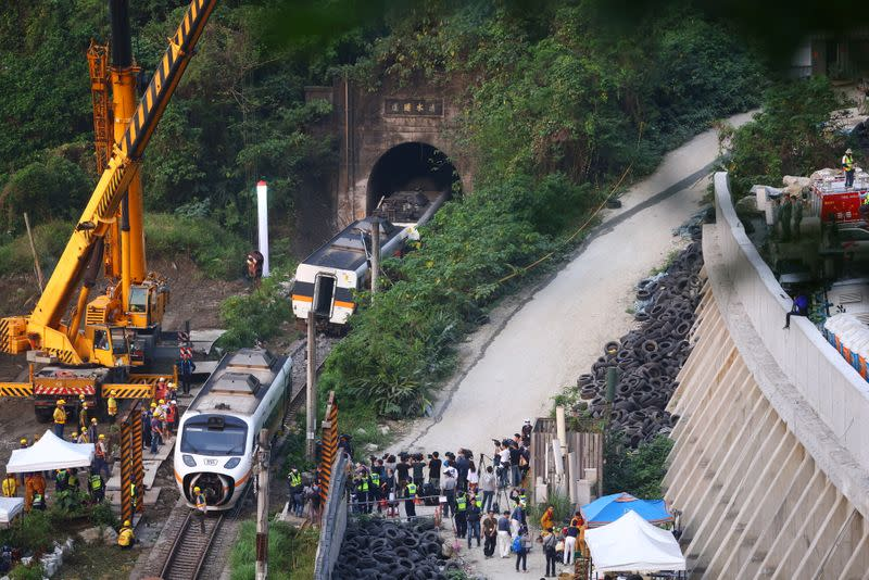 Rescuers work at the site a day after a deadly train derailment at a tunnel north of Hualien, Taiwan