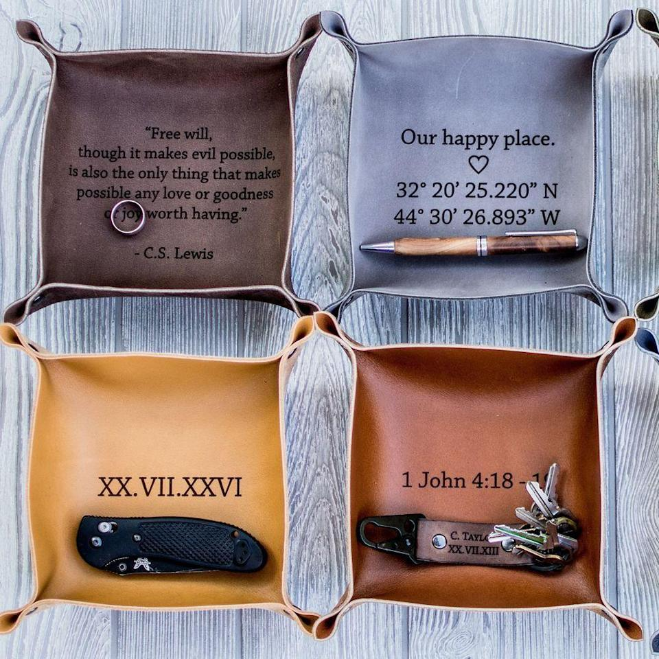 """<p><strong>Etsy</strong></p><p>etsy.com</p><p><strong>$24.35</strong></p><p><a href=""""https://go.redirectingat.com?id=74968X1596630&url=https%3A%2F%2Fwww.etsy.com%2Flisting%2F685112109%2Fengraved-leather-valet-tray-handmade&sref=https%3A%2F%2Fwww.bestproducts.com%2Flifestyle%2Fg27420749%2Fengraved-gifts%2F"""" rel=""""nofollow noopener"""" target=""""_blank"""" data-ylk=""""slk:Shop Now"""" class=""""link rapid-noclick-resp"""">Shop Now</a></p><p>Get any personal message or sentiment engraved on this leather tray. Perfect for holding all their essentials, this tray comes in six different colors. </p>"""