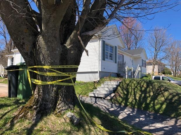 Police tape marks the scene on St. Peters Road in Charlottetown where Nathan Burke died on Saturday. (Brian Higgins/CBC - image credit)