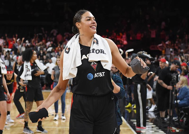 LAS VEGAS, NEVADA - SEPTEMBER 22: Liz Cambage #8 of the Las Vegas Aces throws T-shirts to the crowd after the Aces beat the Washington Mystics 92-75 in Game Three of the 2019 WNBA Playoff semifinals at the Mandalay Bay Events Center on September 22, 2019 in Las Vegas, Nevada. NOTE TO USER: User expressly acknowledges and agrees that, by downloading and or using this photograph, User is consenting to the terms and conditions of the Getty Images License Agreement. (Photo by Ethan Miller/Getty Images)