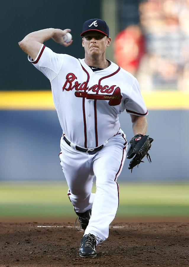 Atlanta Braves starting pitcher Gavin Floyd (32) works in the first inning of a baseball game against the St. Louis Cardinals, Tuesday, May 6, 2014, in Atlanta. (AP Photo/John Bazemore)