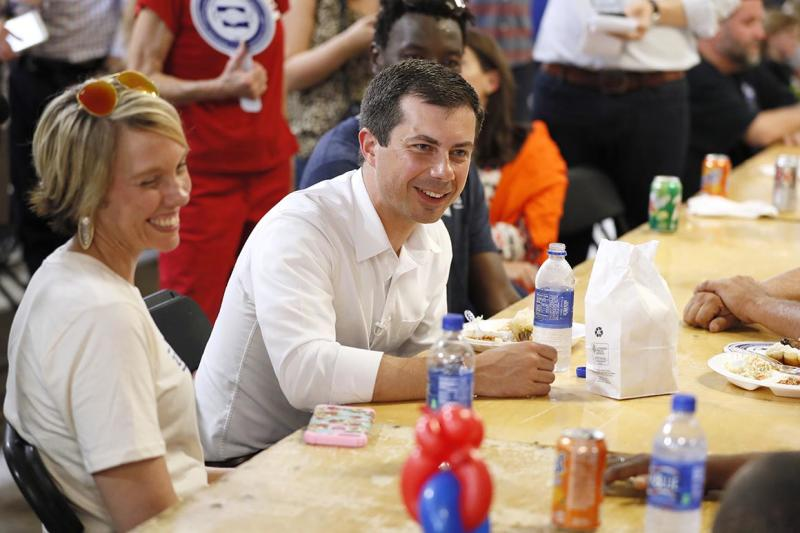 Democratic presidential candidate Pete Buttigieg speaks with local residents at the Hawkeye Area Labor Council Labor Day Picnic, Monday, Sept. 2, 2019, in Cedar Rapids, Iowa. (AP Photo/Charlie Neibergall)