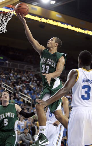 Cal Poly forward Chris Eversley (33) goes for a layup as UCLA's Jordan Adams (3) looks on during the first half of an NCAA college basketball game in Los Angeles, Sunday, Nov. 25, 2012. (AP Photo/Jason Redmond)