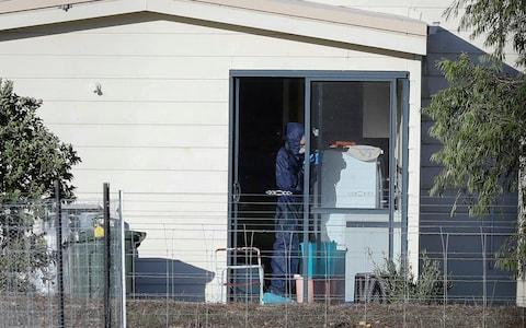 <span>Police forensics investigate the death of seven people in a suspected murder-suicide in Osmington</span> <span>Credit: Richard Wainwright/AAP Image </span>
