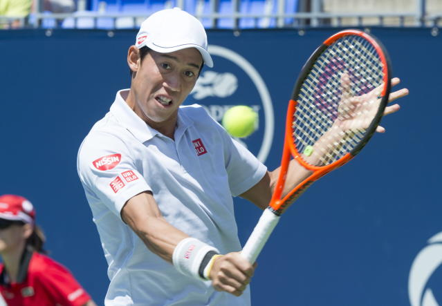 FILE – In this Aug. 9, 2017, file photo, Kei Nishikori, of Japan, returns to Gael Monfils, of France, during second round of play at the Rogers Cup tennis tournament, in Montreal. Nishikori is the latest top player to pull out of the U.S. Open because of an injury. The agent for the 2014 runner-up and 2016 semifinalist at Flushing Meadows says Nishikori is going to miss the rest of this season because of a torn tendon in his right wrist. (Paul Chiasson/The Canadian Press via AP, File)