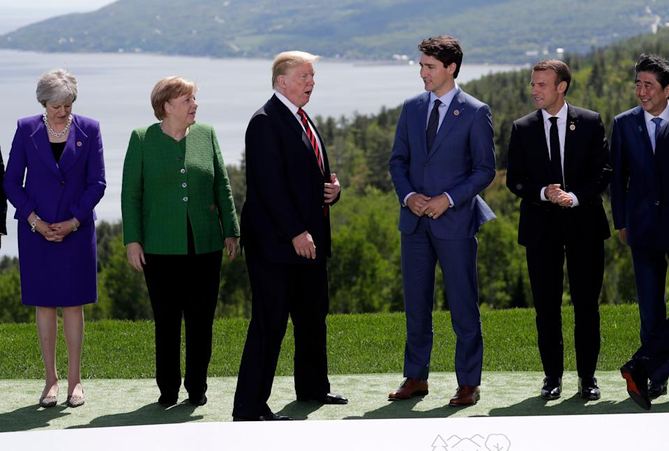 From left to right, British Prime Minister Theresa May, German Chancellor Angela Merkel, President Trump, Canadian Prime Minister Justin Trudeau, French President Emmanuel Macron, Japanese Prime Minister Shinzo Abe gather for a photo at the G-7 summit.