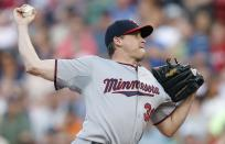 Minnesota Twins' Kevin Correia pitches during the first inning of a baseball game against the Boston Red Sox in Boston, Monday, June 16, 2014. (AP Photo/Michael Dwyer)