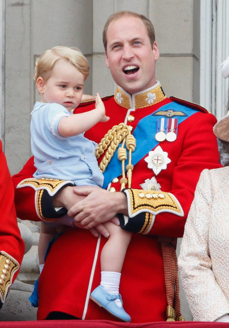 LONDON, UNITED KINGDOM - JUNE 13: (EMBARGOED FOR PUBLICATION IN UK NEWSPAPERS UNTIL 48 HOURS AFTER CREATE DATE AND TIME) Prince William, Duke of Cambridge carries his son Prince George of Cambridge as he stands on the balcony of Buckingham Palace during Trooping the Colour on June 13, 2015 in London, England. The ceremony is Queen Elizabeth II's annual birthday parade and dates back to the time of Charles II in the 17th Century, when the Colours of a regiment were used as a rallying point in battle. (Photo by Max Mumby/Indigo/Getty Images)