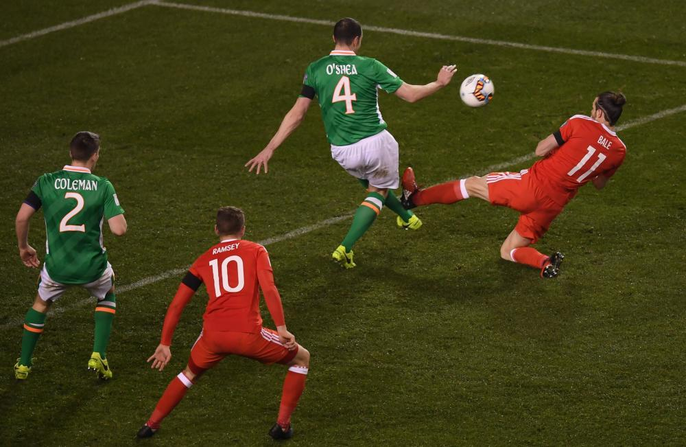 Gareth Bale flies in on John O'Shea.
