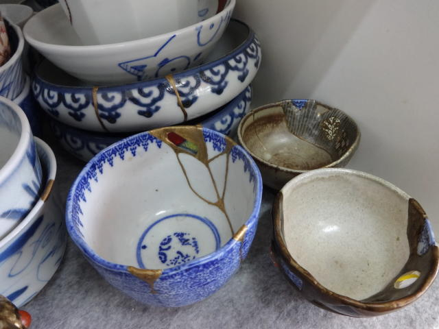 This Nov. 11, 2018 photo shows an example of Kintsugi at the Kuge Crafts workshop in Tokyo. Kintsugi is an ancient Japanese method of repairing broken pottery with gold that creates a new work of art. (Linda Lombardi via AP)