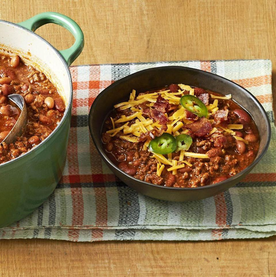"""<p>A big pot of chili will be the coziest addition to your Sunday. This version is packed with beef and beans for a filling bowl.</p><p><strong><a href=""""https://www.thepioneerwoman.com/food-cooking/recipes/a34225821/beef-and-bean-chili-recipe/"""" rel=""""nofollow noopener"""" target=""""_blank"""" data-ylk=""""slk:Get the recipe."""" class=""""link rapid-noclick-resp"""">Get the recipe.</a></strong></p><p><strong><a class=""""link rapid-noclick-resp"""" href=""""https://go.redirectingat.com?id=74968X1596630&url=https%3A%2F%2Fwww.walmart.com%2Fsearch%2F%3Fquery%3Dpioneer%2Bwoman%2Bdutch%2Boven&sref=https%3A%2F%2Fwww.thepioneerwoman.com%2Ffood-cooking%2Fmeals-menus%2Fg35049189%2Fsuper-bowl-food-recipes%2F"""" rel=""""nofollow noopener"""" target=""""_blank"""" data-ylk=""""slk:SHOP DUTCH OVENS"""">SHOP DUTCH OVENS</a><br></strong></p>"""