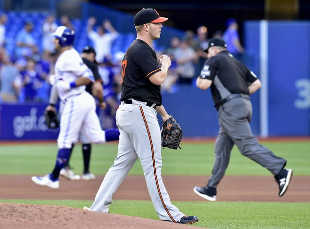 Baltimore Orioles starting pitcher Dylan Bundy, center, reacts after giving up a home run during fifth-inning baseball game action against the Toronto Blue Jays in Toronto, Friday, July 20, 2018. (Frank Gunn/The Canadian Press via AP)