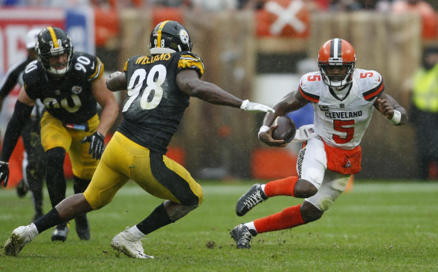 Cleveland Browns quarterback Tyrod Taylor (5) scrambles against Pittsburgh Steelers linebacker Vince Williams (98) during the first half of an NFL football game, Sunday, Sept. 9, 2018, in Cleveland. (AP Photo/Ron Schwane)