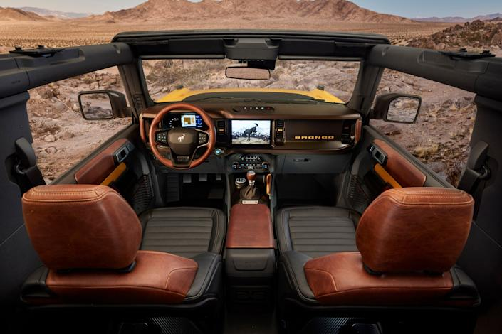 """<h1 class=""""title"""">2021 Bronco Interior</h1> <div class=""""caption""""> Interior of the 2021 Bronco, which features an open-air-design roof. </div> <cite class=""""credit"""">Photo: Courtesy of Bronco</cite>"""