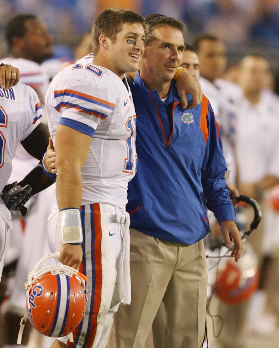 Tim Tebow (left) and former Florida coach Urban Meyer shown during a game in 2008.