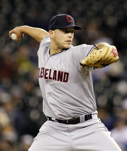 Cleveland Indians starting pitcher Justin Masterson throws to the Seattle Mariners in the first inning of a baseball game Tuesday, April 17, 2012, in Seattle. (AP Photo/Elaine Thompson)