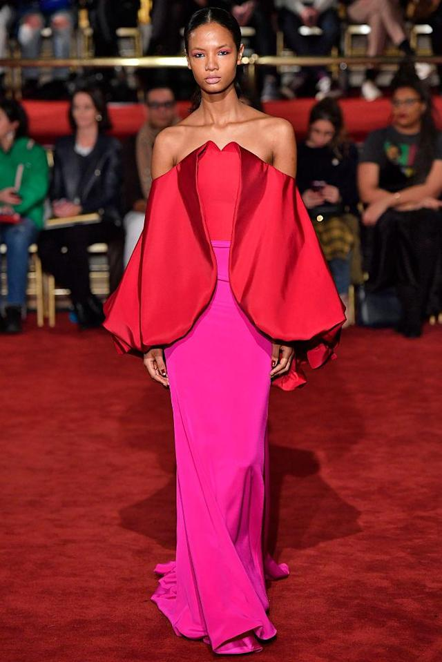 <p>A strapless red-and-pink gown at the Christian Siriano FW18 show. (Photo: Getty) </p>