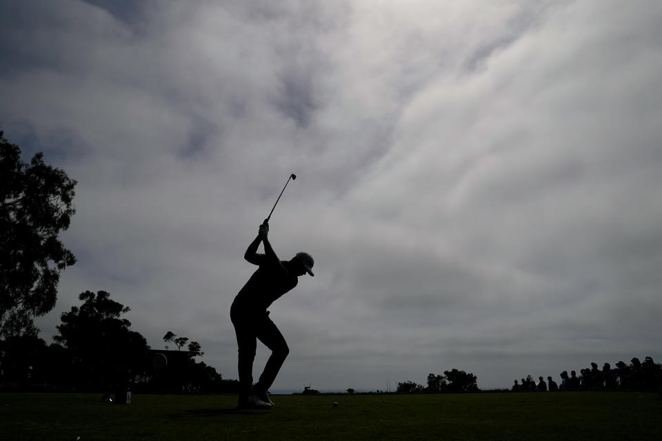 Matthew Wolff plays his shot from the 11th tee during the third round of the U.S. Open Golf Championship, Saturday, June 19, 2021, at Torrey Pines Golf Course in San Diego. (AP Photo/Jae C. Hong)