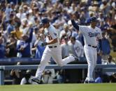Los Angeles Dodgers starting pitcher Clayton Kershaw, left, rounds the bases after hitting a home run against the San Francisco Giants during the eighth inning of a season opening baseball game in Los Angeles, Monday, April 1, 2013. (AP Photo/Jae C. Hong)