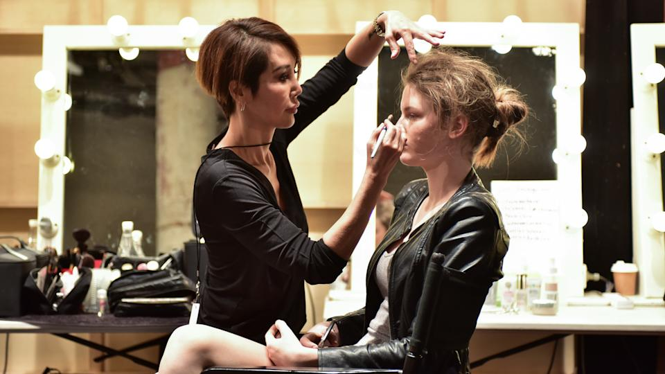 SYDNEY / AUSTRALIA - 20 May: Models, stylists, makeup artists get prepared for show before Raffles International Showcase at Mercedes Benz Fashion Week Australia on 20 May 2016 in Carriageworks Sydney.