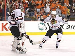 Patrick Kane rejoices with goalie Antti Niemi after scoring the Cup-clinching goal in overtime