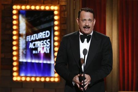 Actor Tom Hanks takes the stage before presenting the award for Best Performance By an Actress in a Featured Role in a Play during the American Theatre Wing's annual Tony Awards in New York