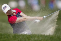 United States' Ally Ewing hits from the bunker on the 11th hole during the singles matches at the Solheim Cup golf tournament, Monday, Sept. 6, 2021, in Toledo, Ohio. (AP Photo/Carlos Osorio)