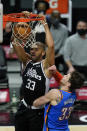 Los Angeles Clippers forward Nicolas Batum (33) dunks the ball against Oklahoma City Thunder center Mike Muscala (33) during the first quarter of an NBA basketball game Sunday, Jan. 24, 2021, in Los Angeles. (AP Photo/Ashley Landis)