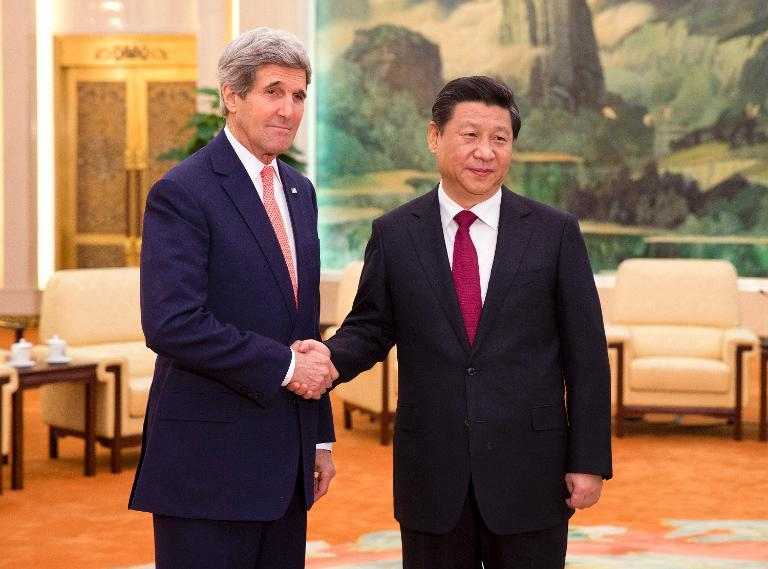 US Secretary of State John Kerry (L) is greeted by Chinese President Xi Jinping, at the Great Hall of the People in Beijing, on February 14, 2014