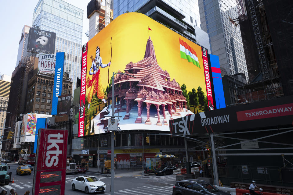 Imagery of the Hindu deity Ram and 3-D portraits of the proposed Hindu temple are displayed on a digital billboard in Times Square, Wednesday, Aug. 5, 2020, to celebrate the groundbreaking ceremony of a temple dedicated to the Hindu god Ram by Indian Prime Minister Narendra Modi in Ayodhya, in New Delhi, India. Hindus rejoiced as Modi broke ground on a long-awaited temple of their most revered god, Ram, at the site of a demolished 16th century mosque. (AP Photo/Mark Lennihan)