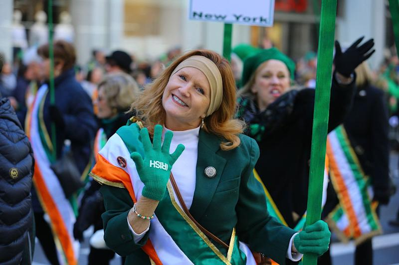 A woman shows off her green Irish gloves while marching in the St. Patrick's Day Parade, March 16, 2019. (Photo: Gordon Donovan/Yahoo News)